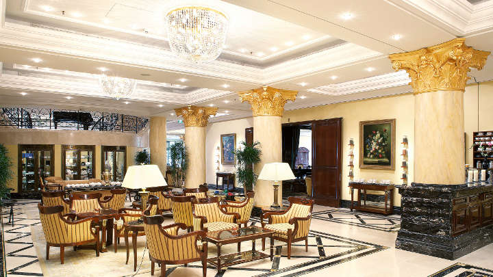 The lobby of Ritz-Carlton Hotel illuminated with chandeliers by Philips Lighting