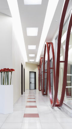 A corridor at AB Group office, Italy, lit with Philips office lighting