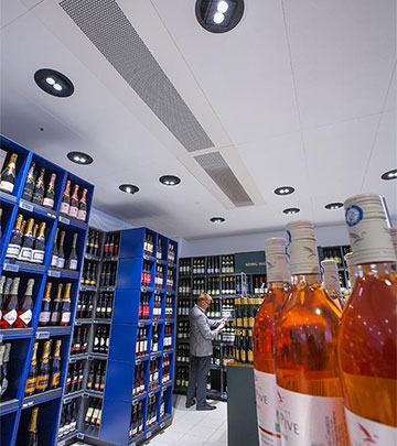Exceptional contrast and sparkle in the wine section at Irma supermarket by Philips lighting products