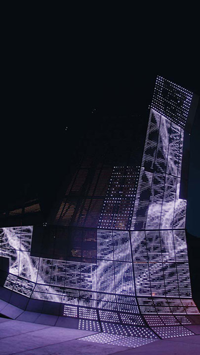 The media facade can respond to climatic data or use pre-planned sequences devised by the artists at Electronic Shadow