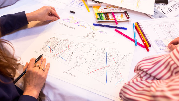 A woman is sketching during a workshop